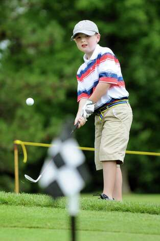 Connor Desjardins, 8, of Niskayuna practices chipping on the green for the Drive, Chip and Putt qualifier for junior golfers on Saturday, July 19, 2014, at Van Patton Golf Course in Clifton Park, N.Y. The event is put on by the Northeastern New York Section PGA Junior Golf Program. (Cindy Schultz / Times Union) Photo: Cindy Schultz / 00027811A