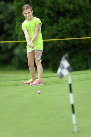 Alexa Cate, 10, of Saratoga Springs practices putting for the Drive, Chip and Putt qualifier for junior golfers on Saturday, July 19, 2014, at Van Patton Golf Course in Clifton Park, N.Y. The event is put on by the Northeastern New York Section PGA Junior Golf Program. (Cindy Schultz / Times Union) Photo: Cindy Schultz / 00027811A
