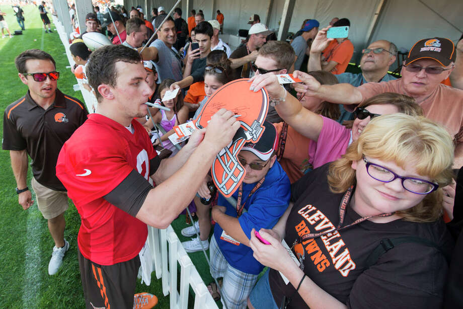 Quarterback Johnny Manziel #2 of the Cleveland Browns signs autographs after practice during training camp at the Cleveland Browns training facility on July 26, 2014 in Berea, Ohio. Photo: Jason Miller, Getty Images / 2014 Getty Images