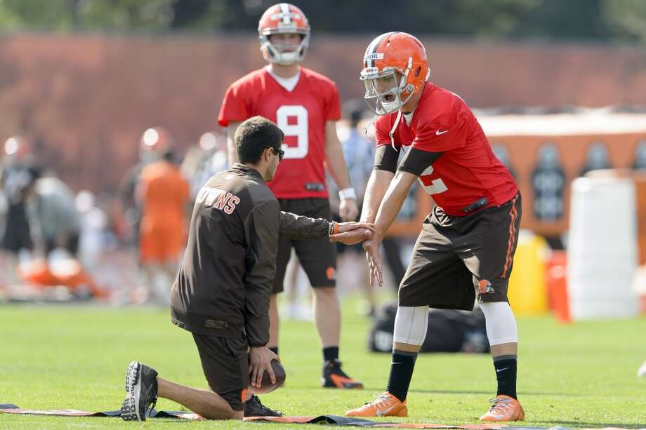 Quarterback Johnny Manziel #2 of the Cleveland Browns takes a snap during training camp at the Cleveland Browns training facility on July 26, 2014 in Berea, Ohio. Photo: Jason Miller, Getty Images
