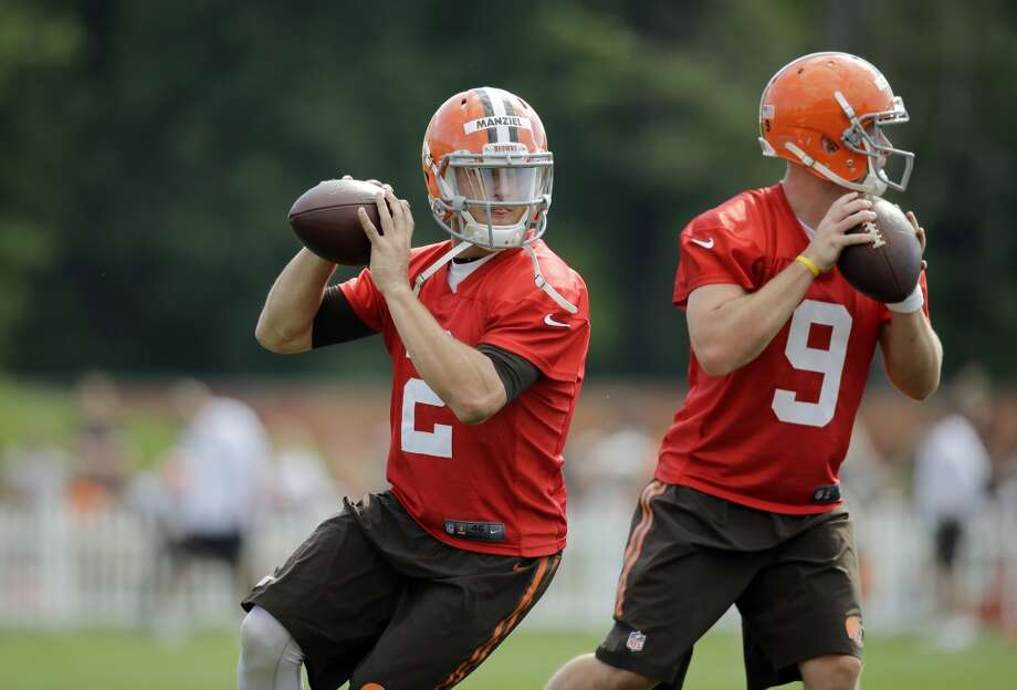 Cleveland Browns quarterback Johnny Manziel (2) drops to pass with Connor Shaw (9) at the NFL football team's training camp in Berea, Ohio Saturday, July 26, 2014. Photo: Mark Duncan, Associated Press