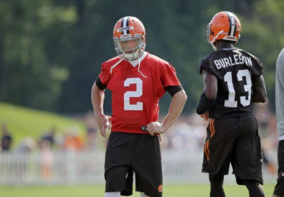 Cleveland Browns quarterback Johnny Manziel (2) talks with wide receiver Nate Burleson (13) at the NFL football team's training camp in Berea, Ohio Saturday, July 26, 2014. Photo: Mark Duncan, Associated Press