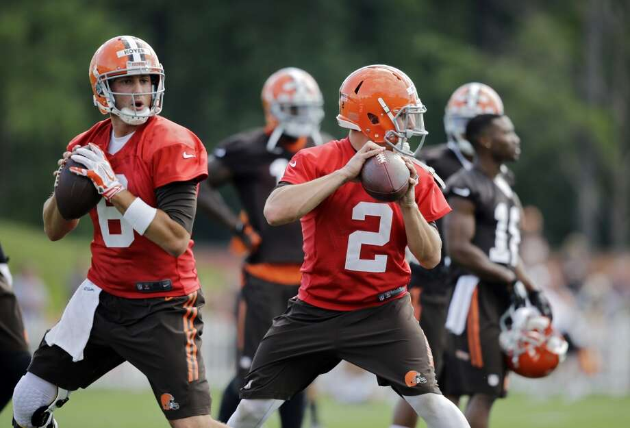 Cleveland Browns quarterback Brian Hoyer (6) and Johnny Manziel (2) drop to pass at the NFL football team's training camp in Berea, Ohio Saturday, July 26, 2014. Photo: Mark Duncan, Associated Press
