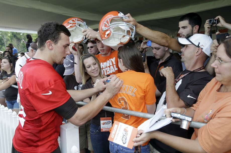 Cleveland Browns quarterback Johnny Manziel signs autographs after practice at the NFL football team's training camp in Berea, Ohio Saturday, July 26, 2014. Photo: Mark Duncan, Associated Press