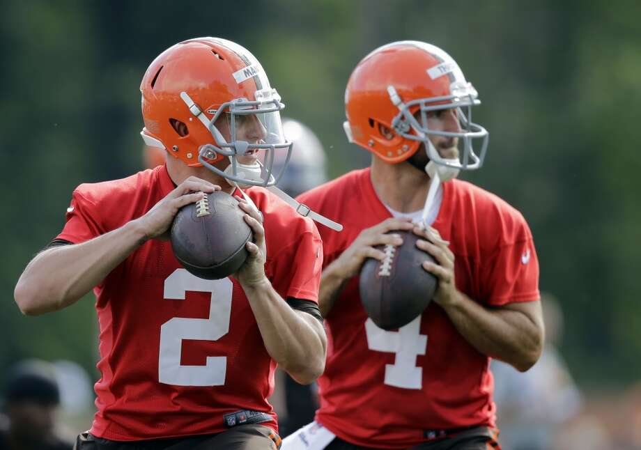 Cleveland Browns quarterback Johnny Manziel (2) drops to pass with Tyler Thigpen (4) during the first practice at the NFL football team's training camp in Berea, Ohio Saturday, July 26, 2014. Photo: Mark Duncan, Associated Press