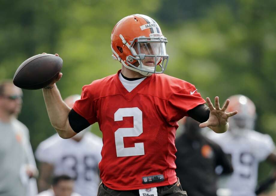 Cleveland Browns quarterback Johnny Manziel (2) passes during the first practice at the NFL football team's training camp in Berea, Ohio Saturday, July 26, 2014. Photo: Mark Duncan, Associated Press