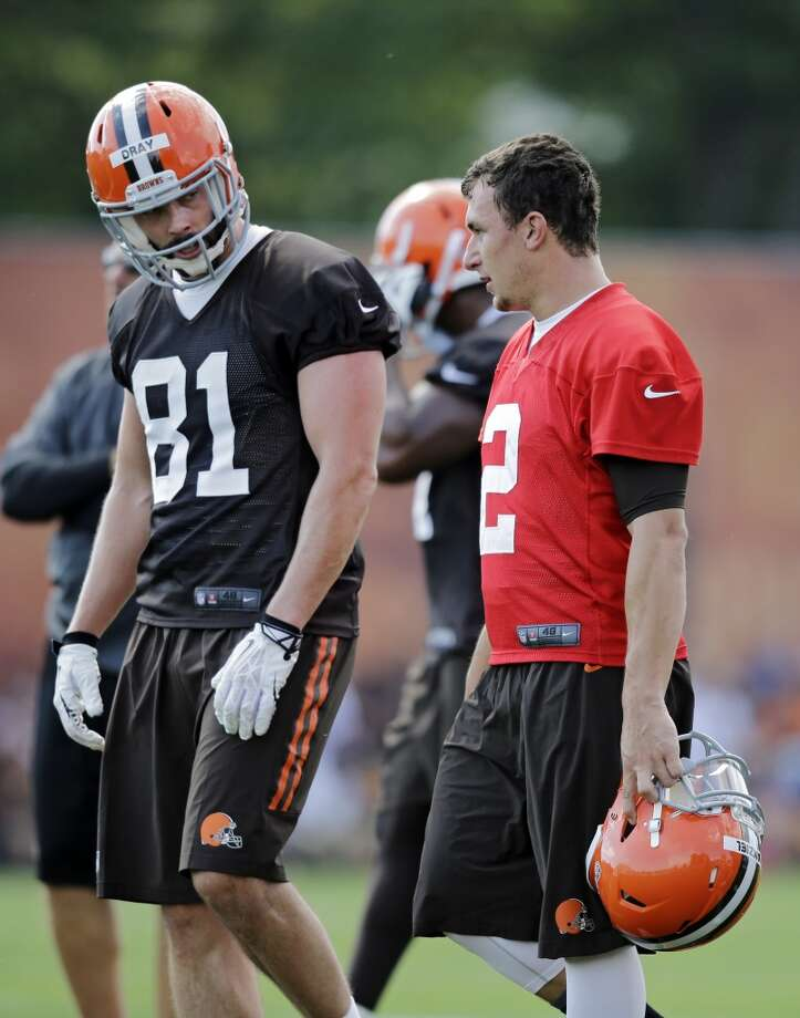 Cleveland Browns quarterback Johnny Manziel (2) talks with tight end Jim Dray (81) during the first practice at the NFL football team's training camp in Berea, Ohio Saturday, July 26, 2014. Photo: Mark Duncan, Associated Press