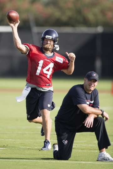Day 1: July 26  Quarterback Ryan Fitzpatrick (14) throws as head co