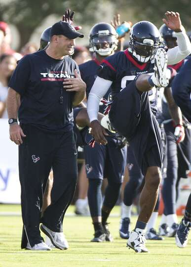 Day 1: July 26  Head coach Bill O'Brien, left, talks to  wide recei