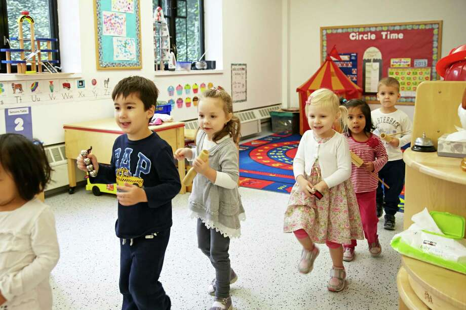 YWCA Greenwich offers 125 age-specific programs, services and events, including the YWCA Greenwich International Preschool, a 10-month, 40-week, educational program. Here, the YWCA International Preschool Marching Band performs in their music class. Pictured, from left are Lucas Furtado, Silvia Sikorska, Elizabeth Smaguine, Tania Samant and Jack Kornberg. Photo: Contributed Photo / Greenwich Time Contributed