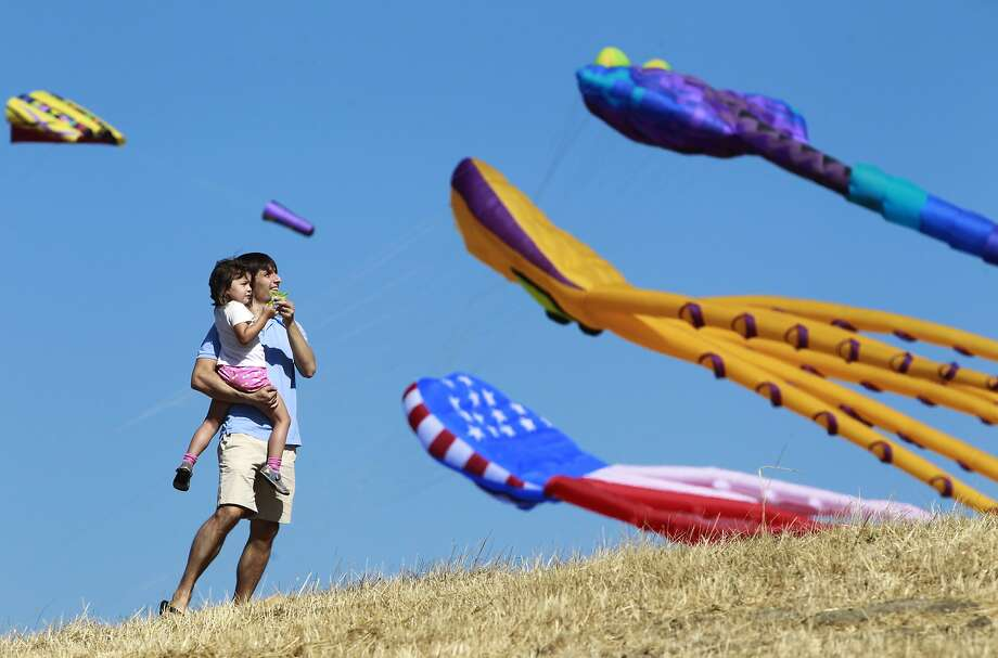 Eric Bevan flies a kite with his daughter Alea, 4, at the 29th annual Berkeley Kite Festival in Berkeley, Calif. on Saturday, July 26, 2014. The two-day event runs through Sunday at Cesar Chavez Park at the Berkeley Marina. Photo: Paul Chinn, The Chronicle