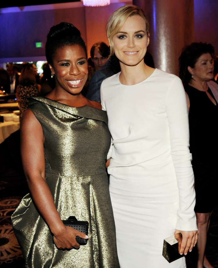 "Uzo Aduba, left, and Taylor Schilling, cast members in the television series ""Orange is the New Black,"" pose together at the 30th Annual Television Critics Association Awards Show at the Beverly Hilton on Saturday, July 19, 2014 in Beverly Hills, Calif. (Photo by Chris Pizzello/Invision/AP) ORG XMIT: CACP104 Photo: Chris Pizzello / Invision"