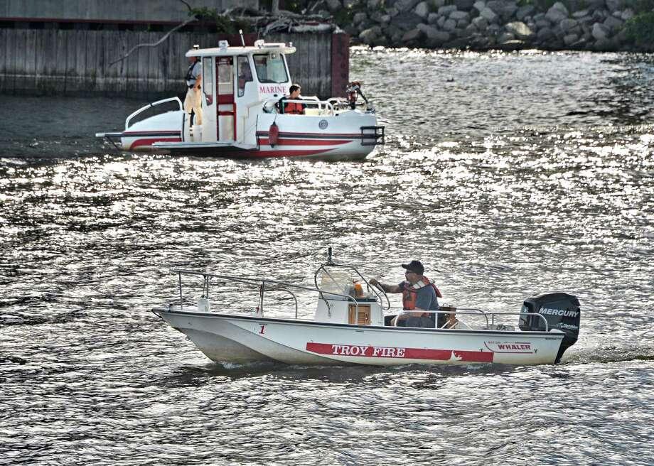 Troy Fire Dept. boats patrol around the Congress Street bridge Saturday July 26, 2014, in Troy, NY.  (John Carl D'Annibale / Times Union) Photo: John Carl D'Annibale