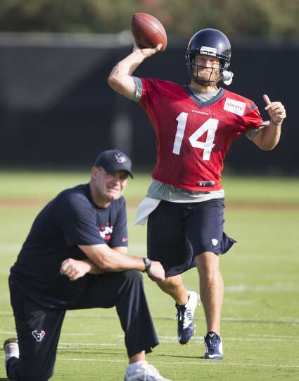 Day 1: July 26  Quarterback Ryan Fitzpatrick (14) throws a pass ove