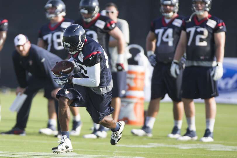Day 1: July 26  Wide receiver Andre Johnson (80) runs after making