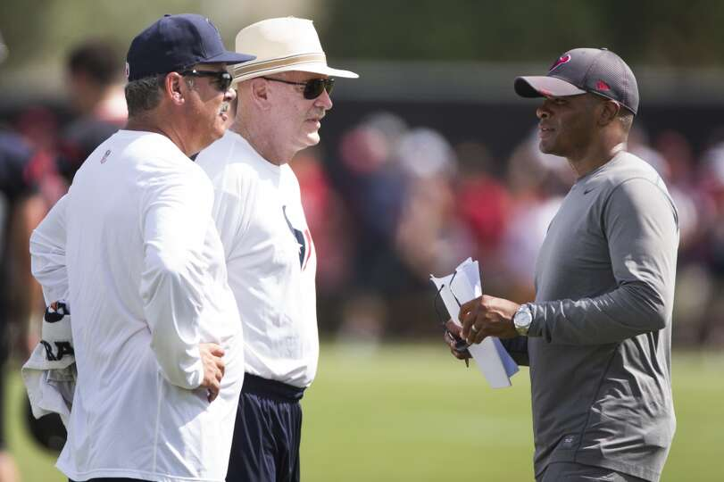 Day 1: July 26  Cal McNair, COO, left, and owner Bob McNair, center