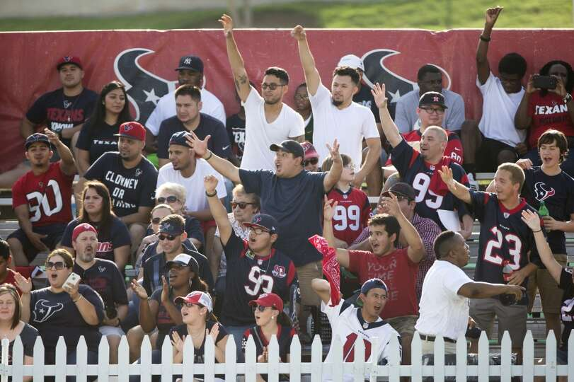 Day 1: July 26  Fans cheer during Texans training camp.