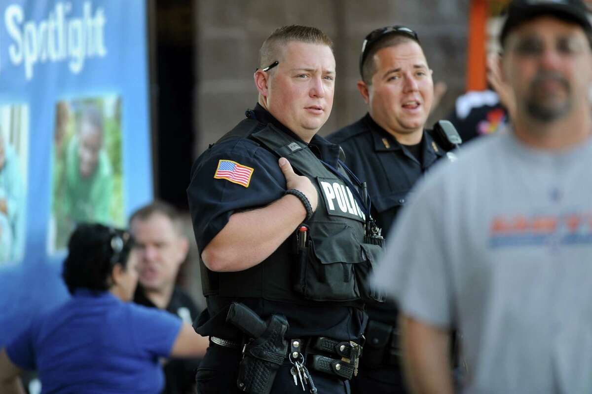 North Greenbush Police Officer Thomas Finn IV, center, and Troy Police Officer Charles Castle III keep watch during the ValleyCats baseball game on Thursday, July 24, 2014, at Bruno Stadium in Troy, N.Y. (Cindy Schultz / Times Union)