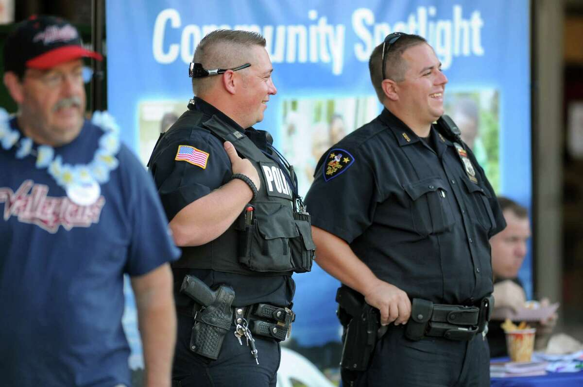 North Greenbush Police Officer Thomas Finn IV, center, and Troy Police Officer Charles Castle III, right, keep watch during the ValleyCats baseball game on Thursday, July 24, 2014, at Bruno Stadium in Troy, N.Y. (Cindy Schultz / Times Union)