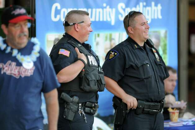 North Greenbush Police Officer Thomas Finn IV, center, and Troy Police Officer Charles Castle III, right, keep watch during the ValleyCats baseball game on Thursday, July 24, 2014, at Bruno Stadium in Troy, N.Y. (Cindy Schultz / Times Union) Photo: Cindy Schultz
