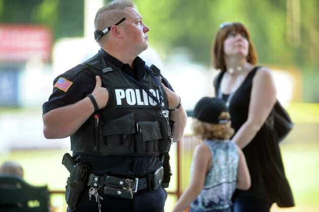 North Greenbush Police Officer Thomas Finn IV, left, keeps watch during the ValleyCats baseball game on Thursday, July 24, 2014, at Bruno Stadium in Troy, N.Y. (Cindy Schultz / Times Union) Photo: Cindy Schultz