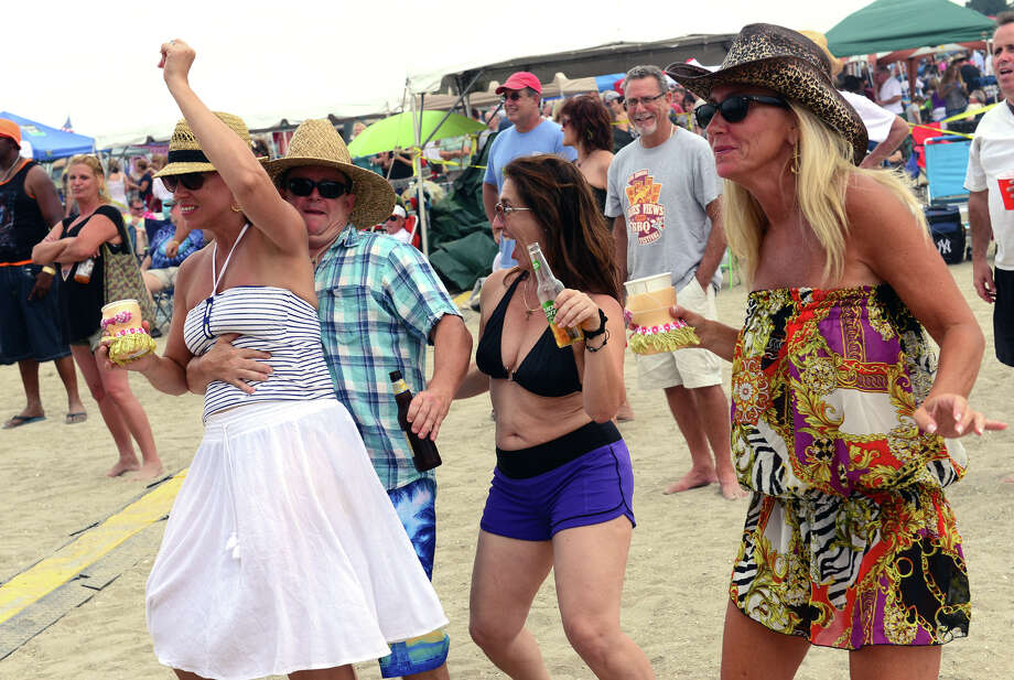 Tami Jackson, her husband Todd, left, Robin Singer, center, and friend Kim Mauear, dance as the Kathy Thompson Band performs during the Blues on the Beach music festival at Short Beach Park in Stratford, Conn. on Saturday July 26, 2014. Photo: Christian Abraham / Connecticut Post