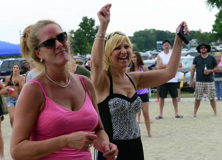 Lori Scianna, left, and her friend Connie DeLorenzo, both of Stratford, enjoy the sounds of the Kathy Thompson Band, during the Blues on the Beach music festival at Short Beach Park in Stratford, Conn. on Saturday July 26, 2014. Photo: Christian Abraham / Connecticut Post