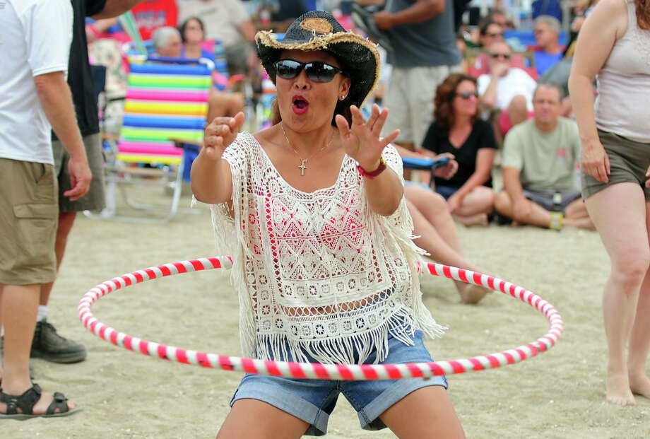 Liza Ramirez, of Stratford, dances with a hoola hoop during the Blues on the Beach music festival at Short Beach Park in Stratford, Conn. on Saturday July 26, 2014. Photo: Christian Abraham / Connecticut Post