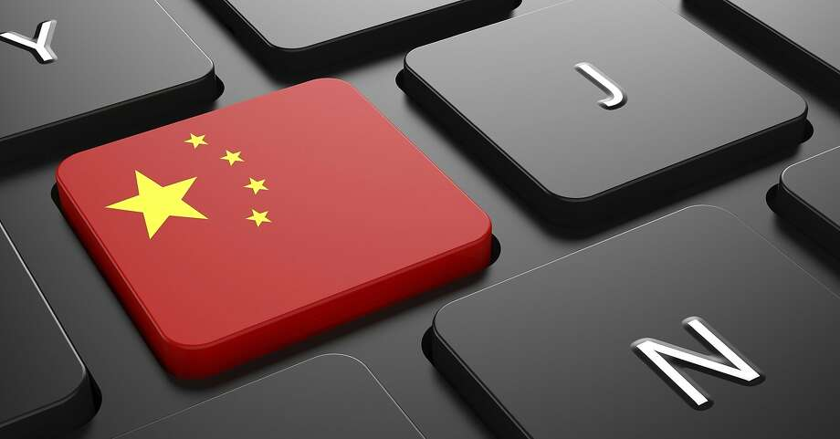 the chinese flag superimposed on a computer keyboard Flag of China - Button on Black Computer Keyboard. Photo: Istockphoto