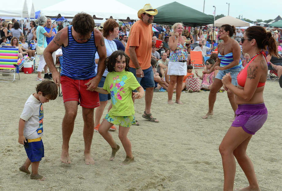 Brian Hazleton dances with his son and daughter, Matteo Cicerchia, 3, and Lucia  Cicerchia, 8, during the Blues on the Beach music festival at Short Beach Park in Stratford, Conn. on Saturday July 26, 2014. At right is their mom Mariana Cicerchia. Photo: Christian Abraham / Connecticut Post