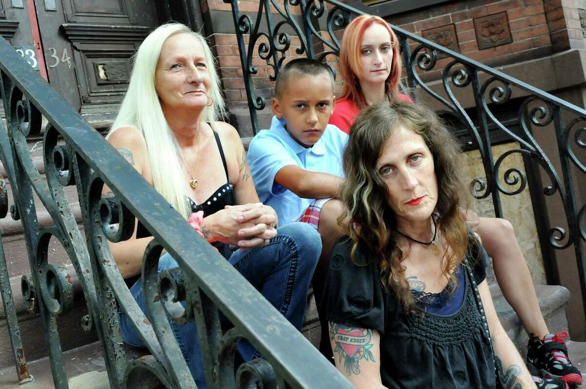 Photographer Brenda A. Kenneally, in front, with Debra Stocklas, left, her grandson DeAnthony Stocklas, 10, center, and her daughter Kayla Stocklas on Saturday, July 26, 2014, in Troy, N.Y. Kenneally has been documenting the lives of her subjects since 2004. (Cindy Schultz / Times Union)