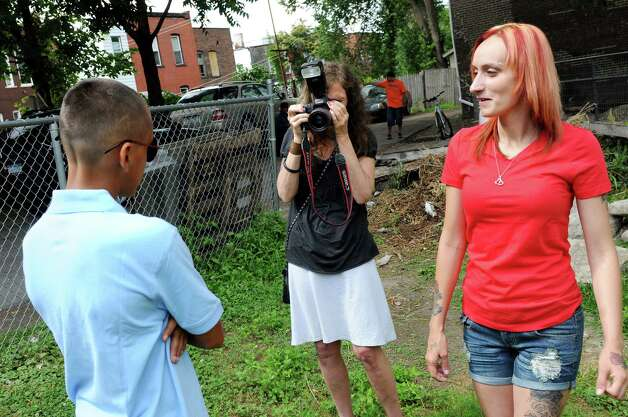 Photographer Brenda A. Kenneally, center, photographs DeAnthony Stocklas, 10, left, as his mother, Kayla Stocklas, joins them on Saturday, July 26, 2014, in Troy, N.Y. Kenneally has been documenting the lives of her subjects since 2004. (Cindy Schultz / Times Union) Photo: Cindy Schultz / 00027942A