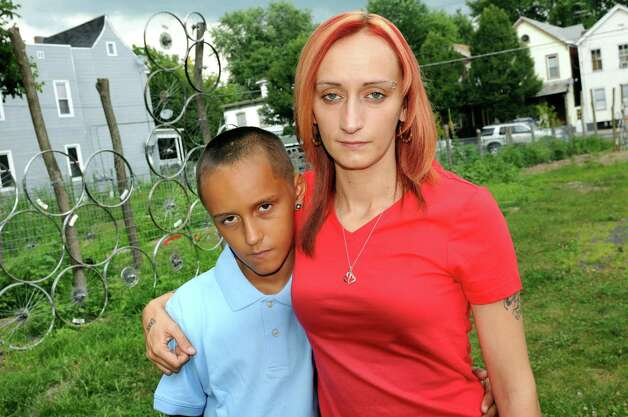 DeAnthony Stocklas, 10, left, and his mother, Kayla Stocklas, on Saturday, July 26, 2014, in Troy, N.Y. Photographer Brenda A. Kenneally has been documenting their lives since 2004. (Cindy Schultz / Times Union) Photo: Cindy Schultz / 00027942A