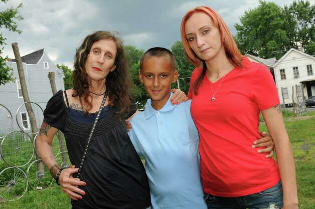 Photographer Brenda A. Kenneally, right, with DeAnthony Stocklas, 10, center, and his mother Kayla Stocklas, on Saturday, July 26, 2014, in Troy, N.Y. Kenneally has been documenting her subjects since 2004. (Cindy Schultz / Times Union) Photo: Cindy Schultz / 00027942A