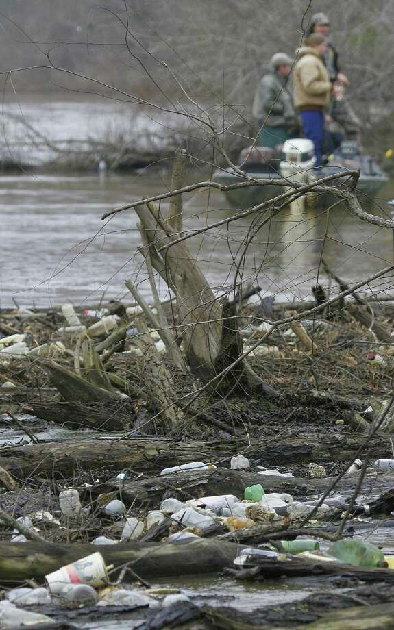 A collection of litter, mostly plastic bottles, fouls the water and moods of anglers on a Texas river. Photo: Picasa
