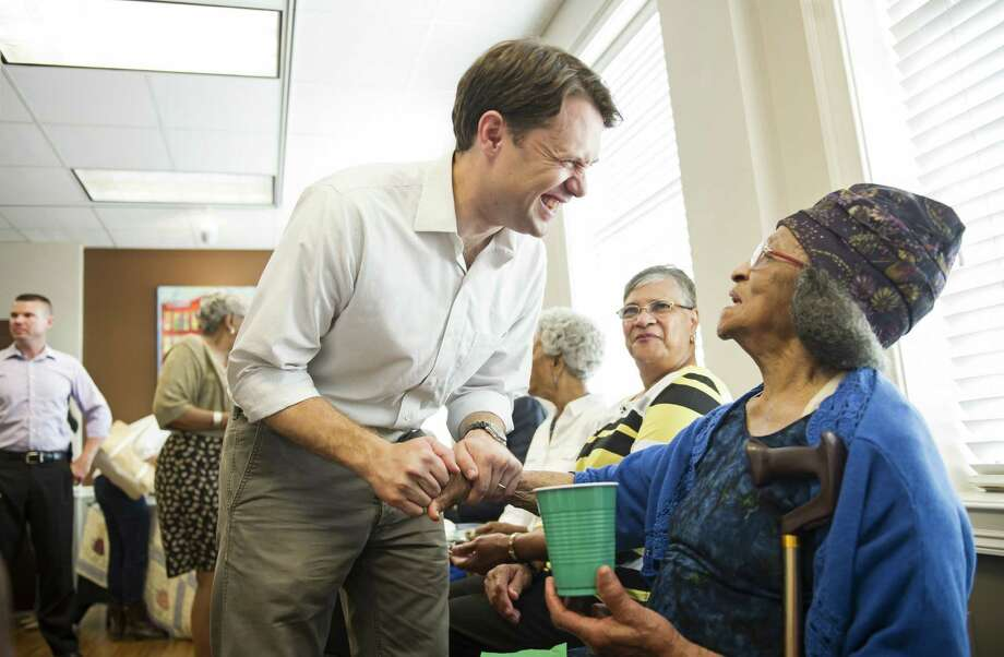 State Sen. Jason Carter, a Democratic nominee for governor in Georgia, visits with Gordon County residents during a reception in Calhoun, Ga. Photo: Jon-Michael Sullivan / New York Times / NYTNS