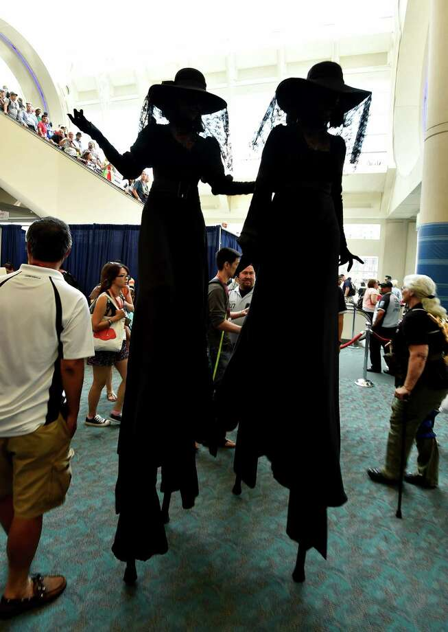"Actors playing characters from the ""American Horror Story: Coven"" walk into the convention center on Day 3 at the 2014 Comic-Con International Convention held on Saturday, July 26, 2014 in San Diego. Photo: Denis Poroy, Denis Poroy/Invision/AP / Invision"