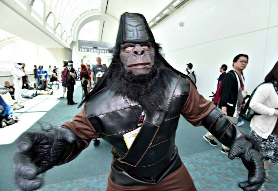 Planet of the Apes character Rocky Johnson walk in the convention center on Day 3 at the 2014 Comic-Con International Convention held Saturday, July 26, 2014, in San Diego. Photo: Denis Poroy, Denis Poroy/Invision/AP / Invision