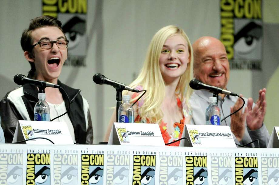 "Isaac Hempstead Wright, left, Elle Fanning, center, and Ben Kingsley attend ""The Boxtrolls"" panel on Day 3 of Comic-Con International on Saturday, July 26, 2014, in San Diego. Photo: Chris Pizzello, Chris Pizzello/Invision/AP / Invision"