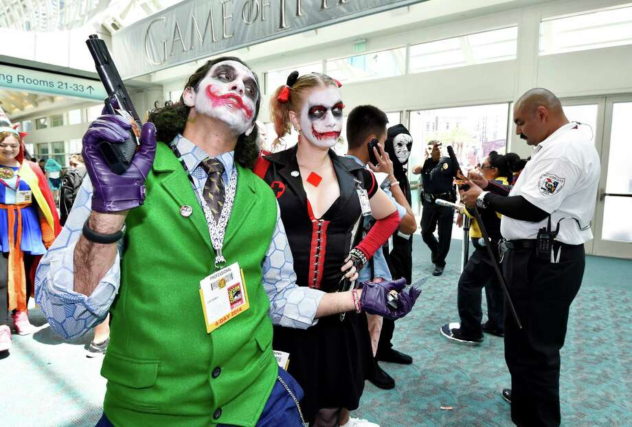 Costumed characters wait in line at a weapons check area on Day 3 at the 2014 Comic-Con International Convention held Saturday, July 26, 2014, in San Diego. Photo: Denis Poroy, Denis Poroy/Invision/AP / Invision
