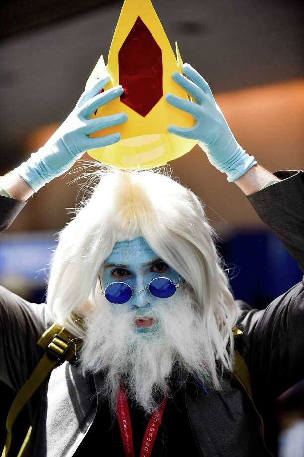 Ice King Dylan Blasenak puts on his crown on Day 3 at the 2014 Comic-Con International Convention held Saturday, July 26, 2014, in San Diego. Photo: Denis Poroy, Denis Poroy/Invision/AP / Invision