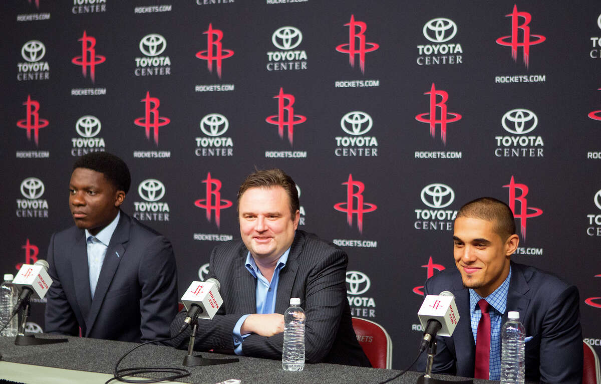 Draft picks center Clint Capela, left, and guard Nick Johnson flank GM Daryl Morey. It's uncertain how much the Rockets' selections will contribute this year.