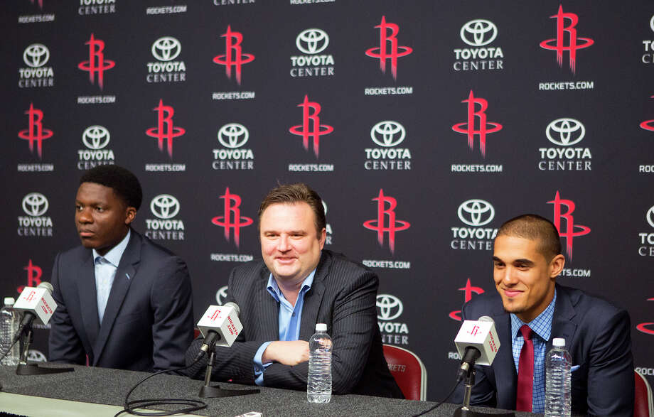 Draft picks center Clint Capela, left, and guard Nick Johnson flank GM Daryl Morey. It's uncertain how much the Rockets' selections will contribute this year. Photo: Cody Duty, Staff / © 2014 Houston Chronicle