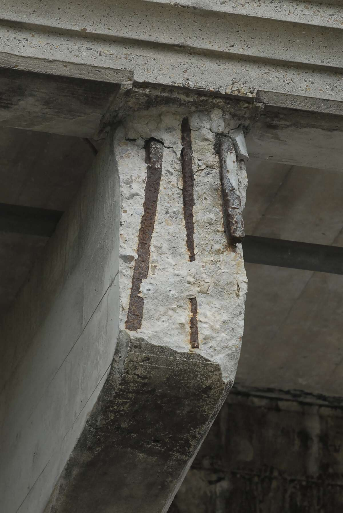 The Yale Street Bridge (built in 1931) at Interstate 10 over White Oak bayou and deteriorating concrete support structures exposing metal rebar photographed Sunday 3/18/12. Photo by Tony Bullard.