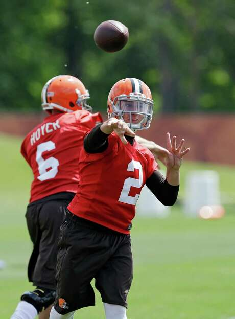 """Rookie quarterback Johnny Manziel had a less than stellar opening practice Saturday, and the Browns reportedly have expressed concerns Manziel's play """"regressed"""" during offseason workouts. Photo: Mark Duncan, STF / AP"""