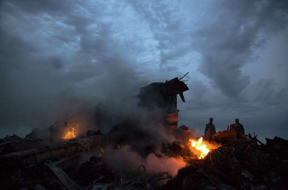 Debris burns after the crash of Malaysia Airlines Flight 17, one of several aircraft struck by missiles provided to Ukrainian separatists by Russia. Photo: Dmitry Lovetsky / Associated Press / AP