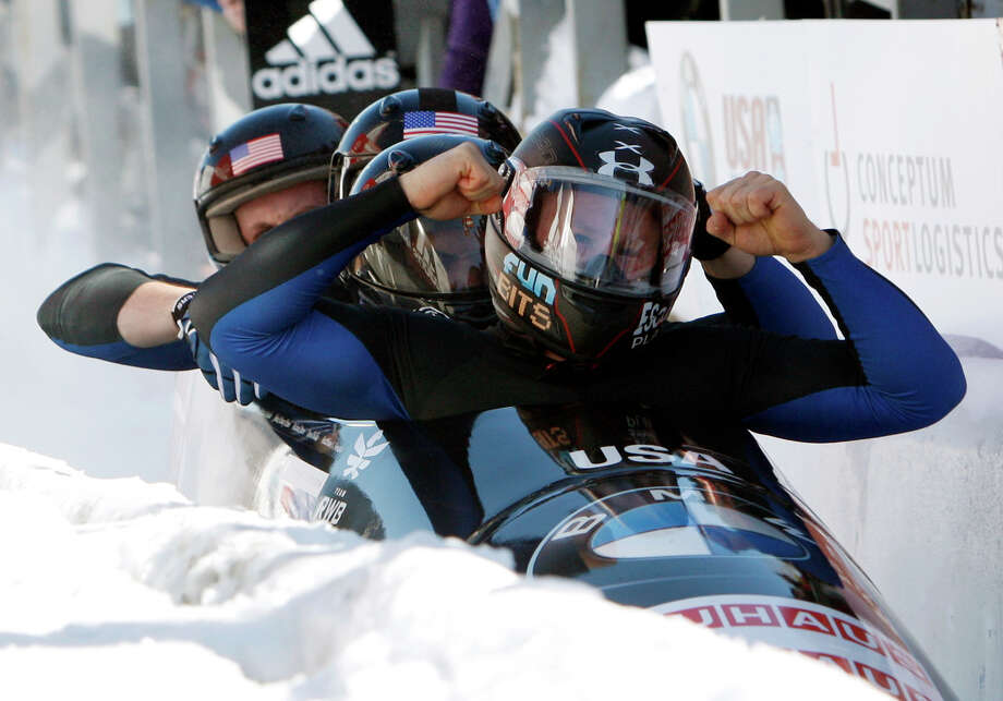 United States' pilot Steven Holcomb, right, with pushers Justin Olsen, Steven Langton and brakeman Curtis Tomasevicz, react after winning the men's four-man Bobsled World Championships in Lake Placid, N.Y., on Sunday, Feb. 26, 2012. (AP Photo/Mike Groll) Photo: AP / AP
