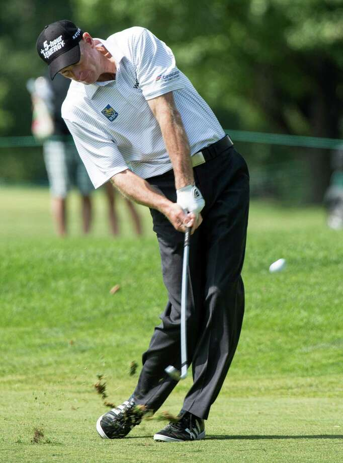 Jim Furyk hits on the ninth fairway during the third round of the Canadian Open golf championship at the Royal Montreal Golf Club in Montreal, Saturday, July 26, 2014. (AP Photo/The Canadian Press, Paul Chiasson) ORG XMIT: PCH107 Photo: Paul Chiasson / The Canadian Press