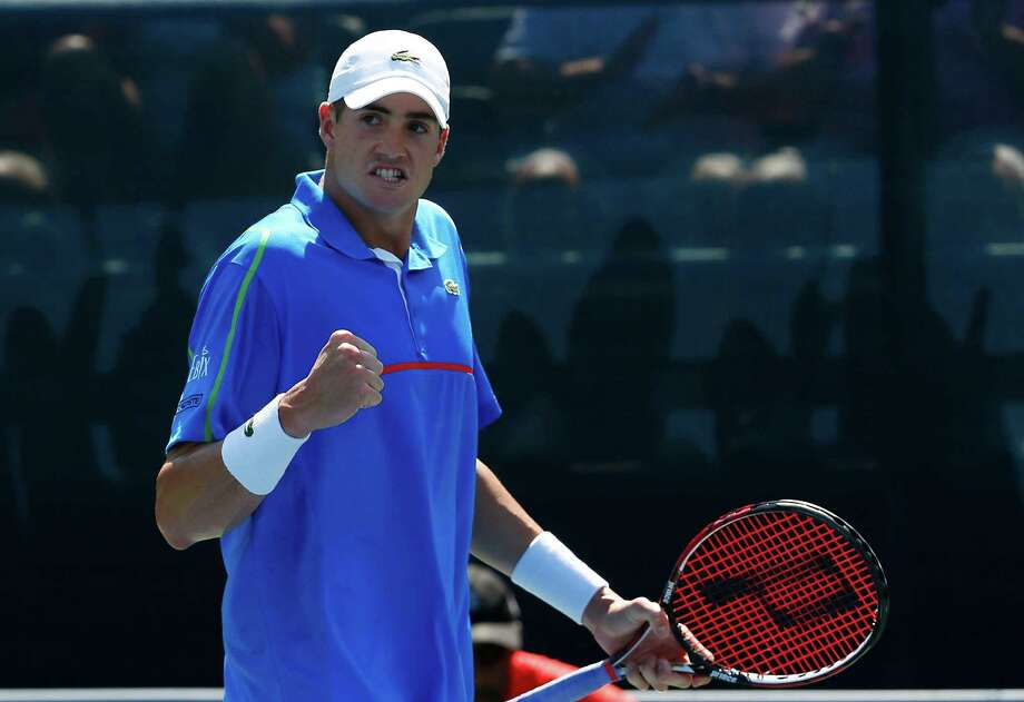 ATLANTA, GA - JULY 26:  John Isner reacts after winning the first set against Jack Sock during the BB&T Atlanta Open at Atlantic Station on July 26, 2014 in Atlanta, Georgia.  (Photo by Kevin C. Cox/Getty Images) ORG XMIT: 502468785 Photo: Kevin C. Cox / 2014 Getty Images