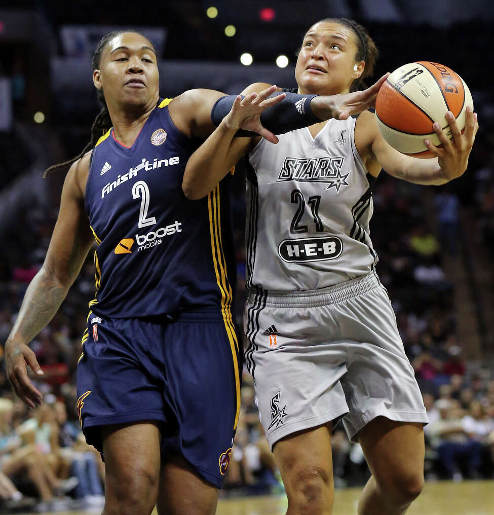 San Antonio Stars' Kayla McBride is fouled by Indiana Fever's Erlana Larkins during first half action Saturday July 26, 2014 at the AT&T Center.